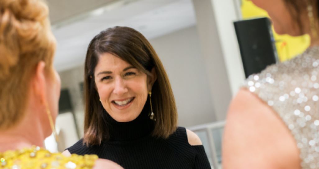Karen Katz of Neiman Marcus smiling at two other women
