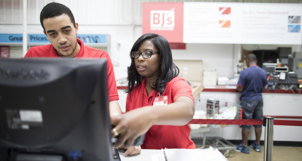BJs employees working at a register