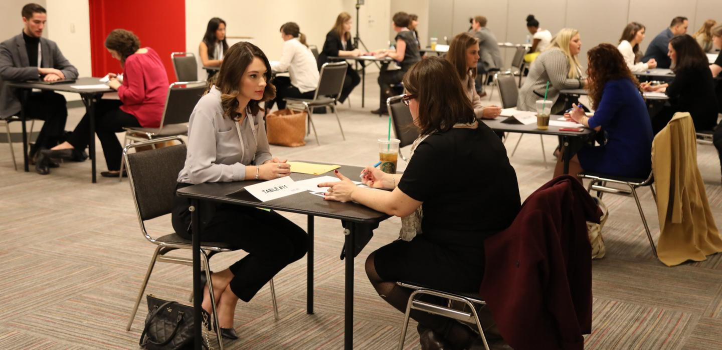 A student getting her resume reviewed at the resume workshop at student program 2017