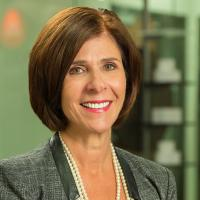 A headshot of Deb Decker, the Chief Client Officer of Alliance Data