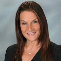 A headshot of Gina Iacovone, the senior vice presdeint of field operations at BJ's Wholesale Club