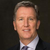 A headshot of Mark Larson, a partner and U.S. retail and consumer leader at KPMG
