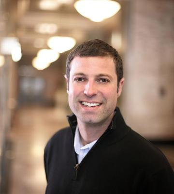 A headshot of Adam Brotman, the Chief Digital Officer at Starbucks