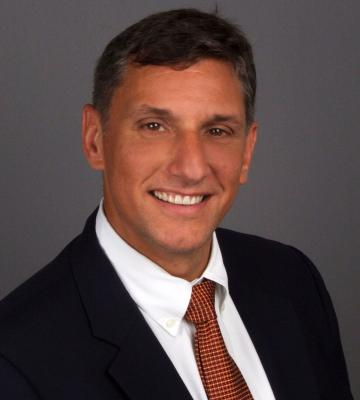 A headshot of Al Sambar, a managing partner at Kurt Salmon North American Retail and Consumer Group