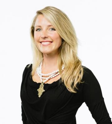 A headshot of Brittany Merrill Underwood, the founder and CEO of Akola Project