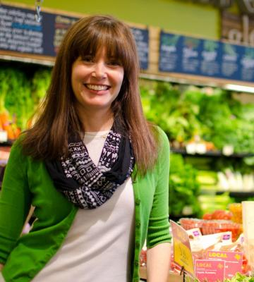 Erin Harper, the senior program manager of Local Loan Producer Program, in a grocery store
