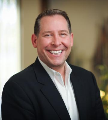 A headshot of Greg Petro, the president and CEO of First Insight