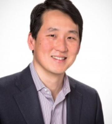 A headshot of James Rhee, and executive chairman and the CEO of Ashley Stewart