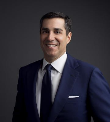 A headshot of Jim Gold, the president and Chief Merchandising Officer of Neiman Marcus