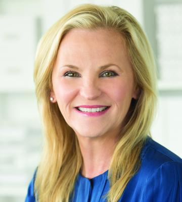 A headshot of Melissa Reiff, the president and COO of The Container Store