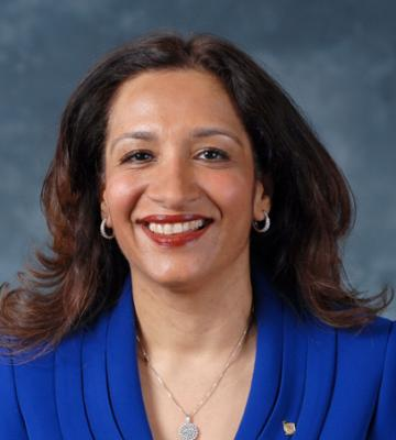 A headshot of Sona Chawla, the president and chief marketing officer of Walgreen Co.