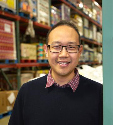A headshot of Chieh Huang, a co-founder and the CEO of Boxed Wholesale, in a warehouse