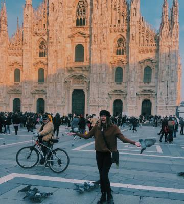 Student posing in front of building in Milan