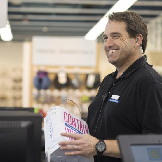 Container Store Employee at Checkout
