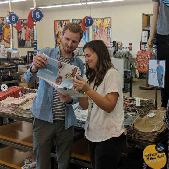 Garrett Ledbetter, General Manager at Old Navy reading something with a colleague