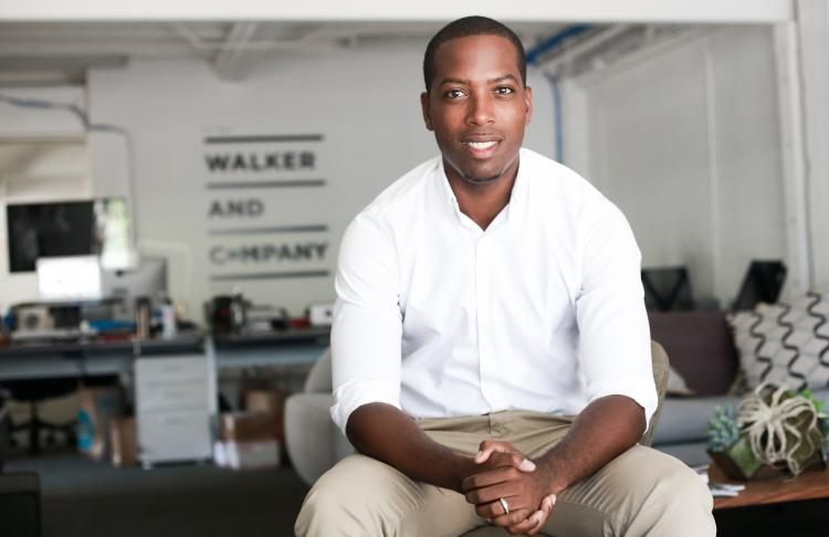 Tritan Walker, the founder and CEO of Walker and Company Brands, in his office